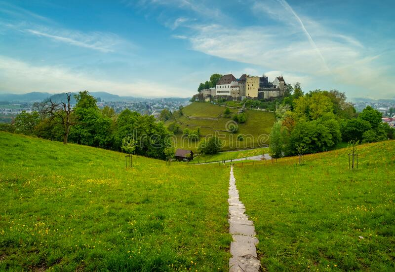 Scenic view of medieval castle of Lenzburg, canton Aargau, Switzerland. Scenic view with footpath leading to medieval castle of Lenzburg, canton Aargau stock image