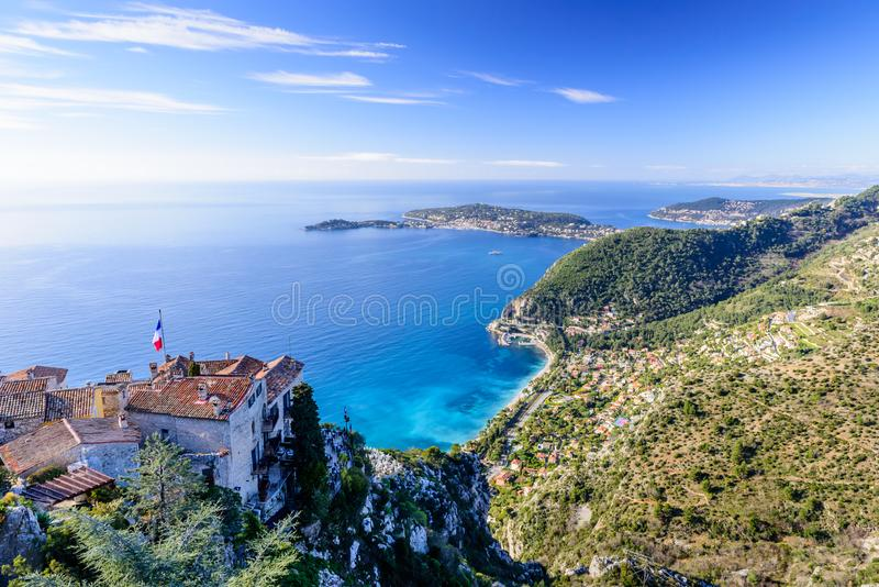 Scenic view of the Mediterranean coastline and medieval houses from the top of the town of Eze village royalty free stock image
