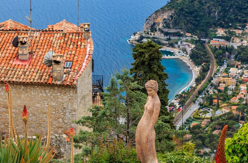 Mediterranean sea and medieval houses in Eze village in France royalty free stock photography