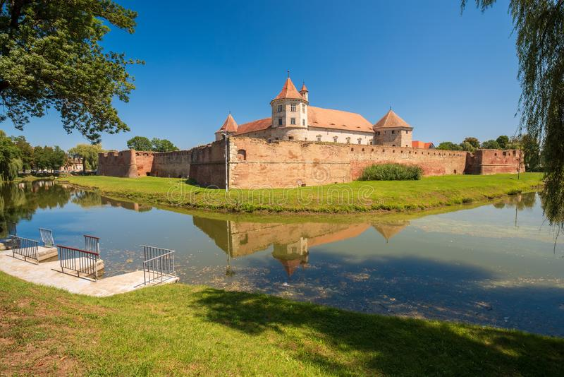 Scenic view of middle ages Fagaras Citadel, Fagaras , Transylvania. Romania. Scenic view of middle ages Fagaras Citadel built in XVth century reflected in the royalty free stock photography