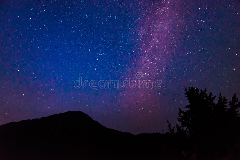 Scenic view of Milky Way and star over Diablo lake in North Cascade national park,Wa,USA.. stock photos