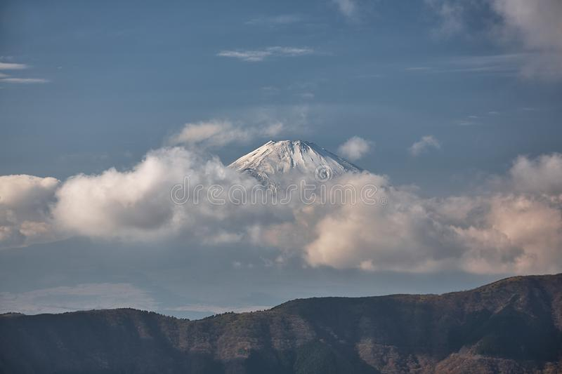 Mount Fuji summit in the clouds. Hakone area of Kanagawa Prefecture in Honshu. Japan. The scenic view of Mount Fuji summit in the clouds from the Hakone mountain royalty free stock photography