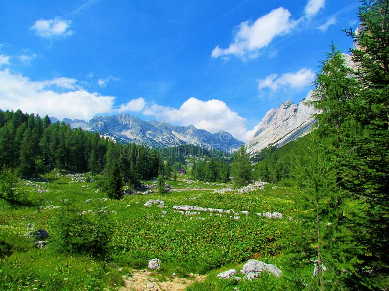 Scenic view of the mountain hut at the Triglav lakes valley. At the Duble lake in Triglav national park and Julian alps in Gorenjska region of Slovenia with royalty free stock photo