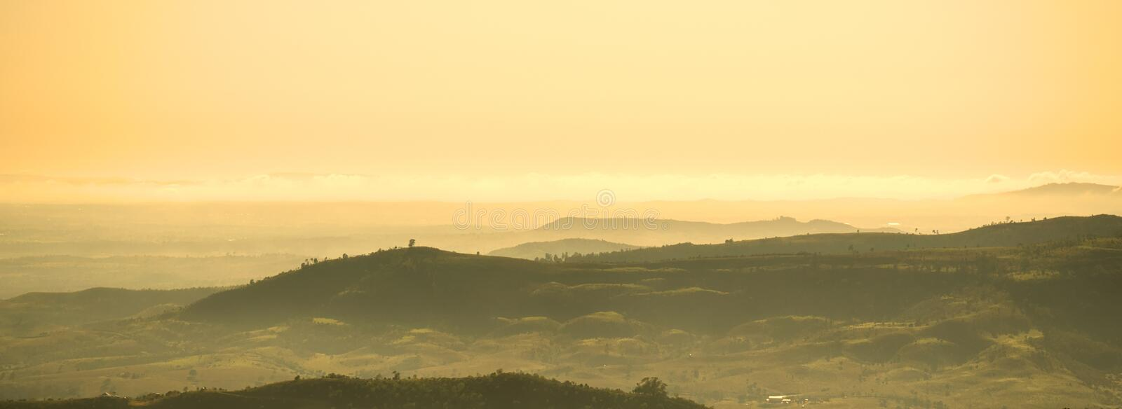 Scenic View of Mountains Against Dramatic Sky royalty free stock photography