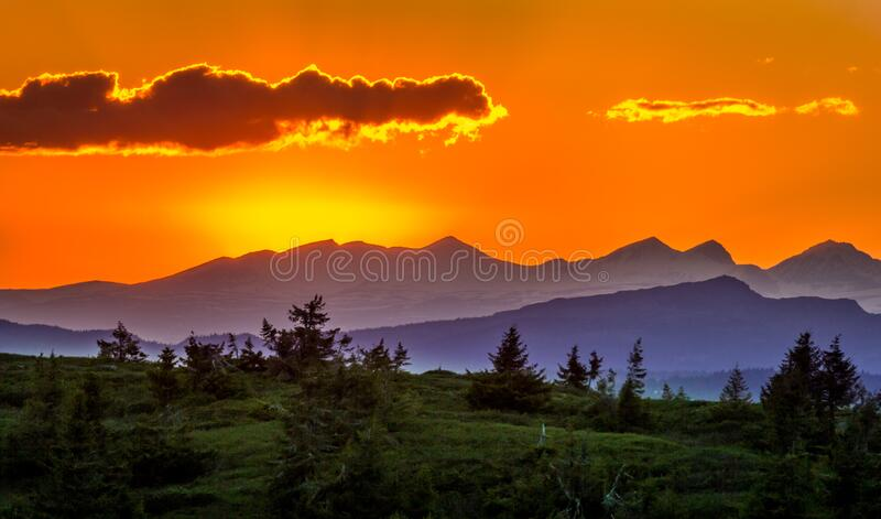 Scenic View of Mountains Against Sky at Sunset stock image