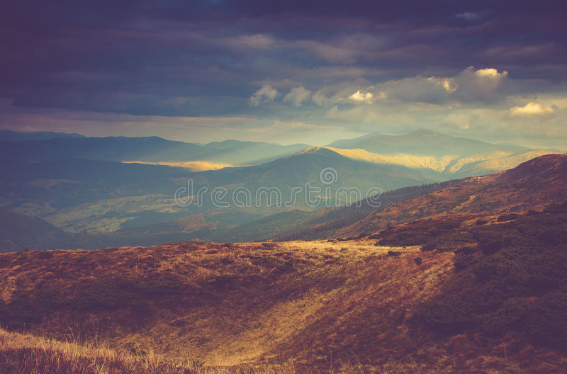 Scenic view of mountains, autumn landscape with colorful hills at sunset. Filtered image:cross processed vintage effect stock image