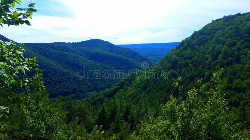 Scenic view of neighboring mountains stock photography