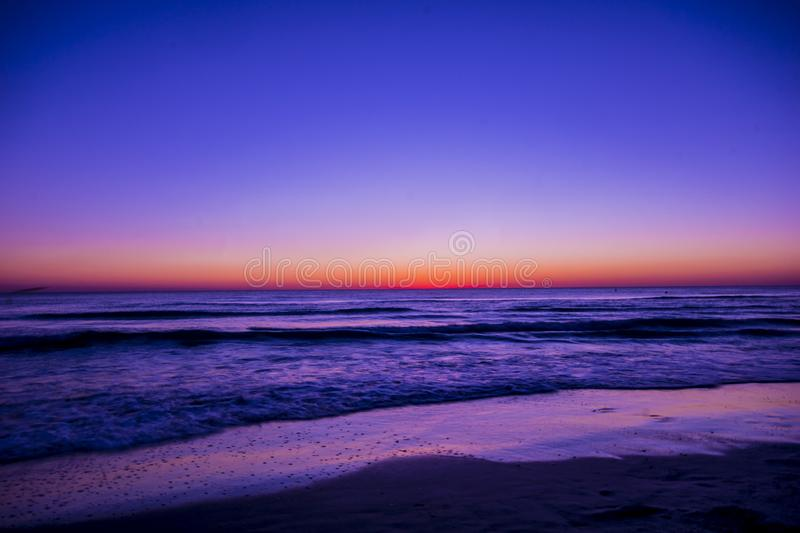 Scenic View of Ocean During Dawn stock image