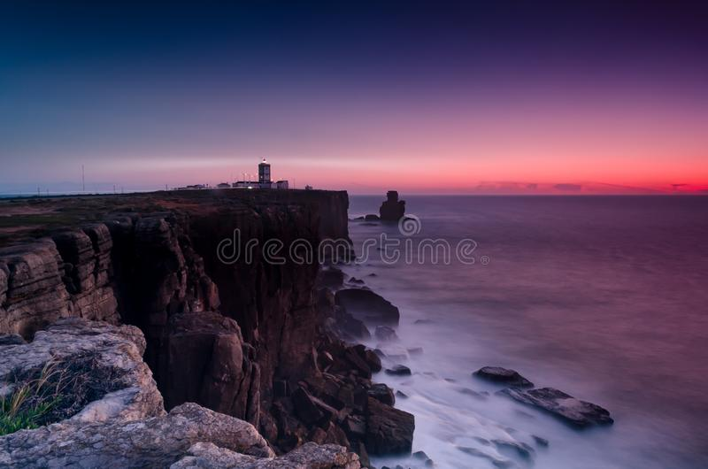 Scenic View Of Ocean Near Cliffs During Dawn stock images