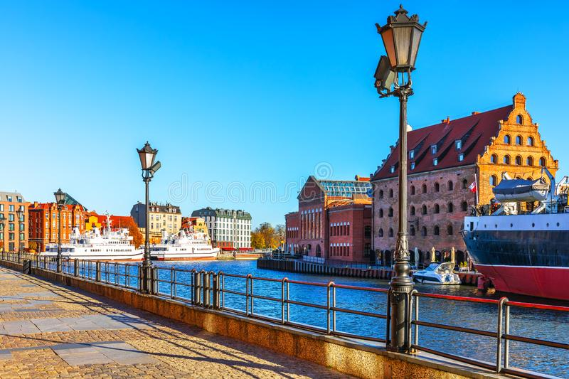 Old Town of Gdansk, Poland. Scenic view of the Old Town pier architecture of Gdansk, Poland at the Motlawa River harbor embankment with medieval port and royalty free stock photos
