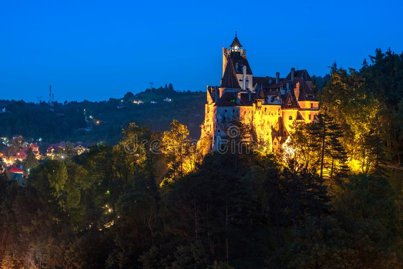 Scenic view over Dracula Bran medieval castle at night, Bran town, Transylvania regio, Romania royalty free stock photography