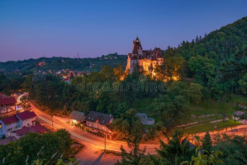 Scenic view over famous Dracula Bran medieval castle at night, Bran town, Transylvania regio, Romania royalty free stock image