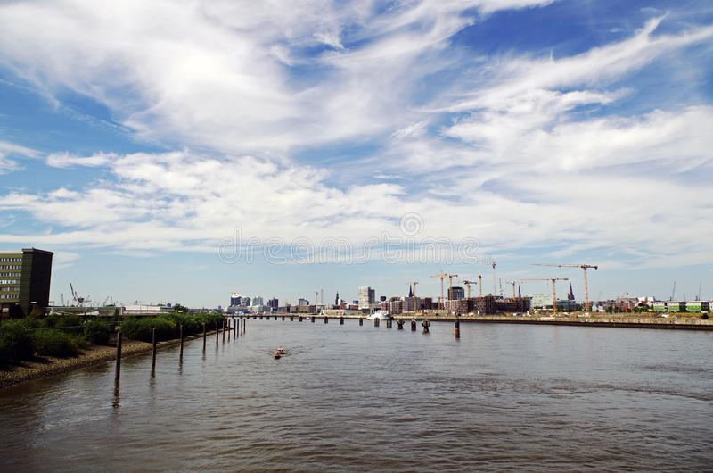 Scenic view over river Elbe against blue and cloudy sky stock photos