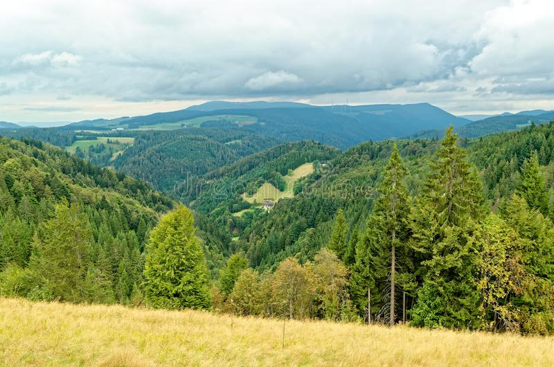Scenic view of a picturesque landscape with mountain forests and cloudy sky. Black Forest region, Germany stock image