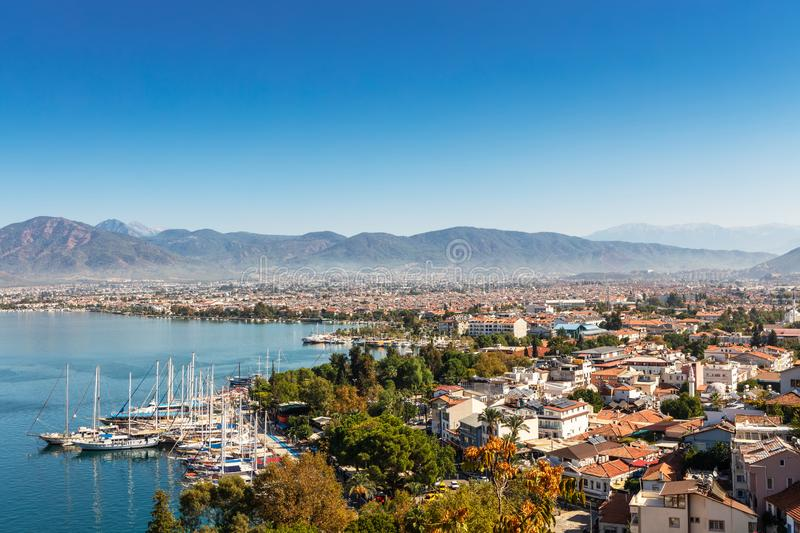 Scenic view of a port city of Fethiye in Turkey. Scenic view of marina and the historic city of Fethiye in Turkey royalty free stock photo