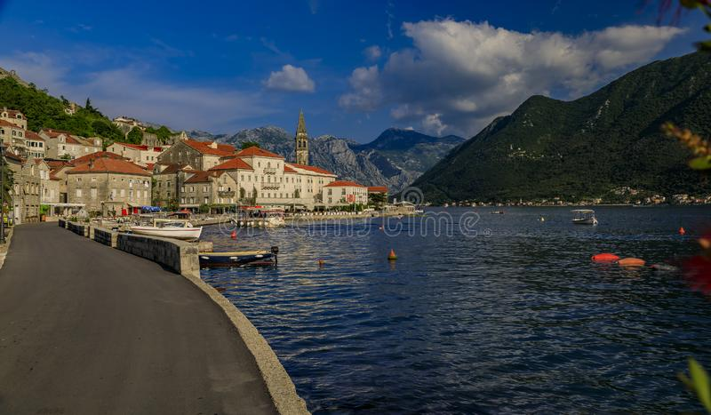 Scenic view of the postcard perfect historic town of Perast in the Bay of Kotor on a sunny day in the summer, Montenegro. Scenic view of a postcard perfect stock image