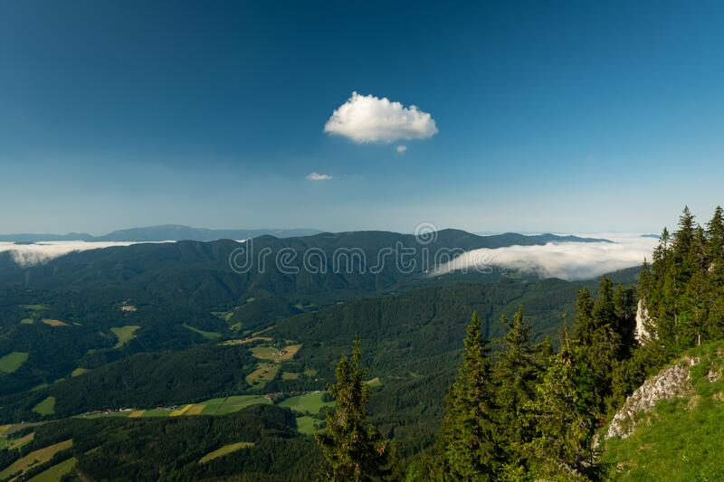 Scenic view from Rax mountains on a sunny morning in summer stock image