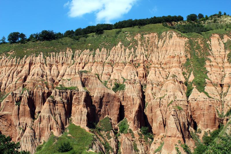Scenic view with the Red Ravine. A unique natural monument with impressive craggy reddish badlands relief near Sebes city, Alba county, Romania royalty free stock photography