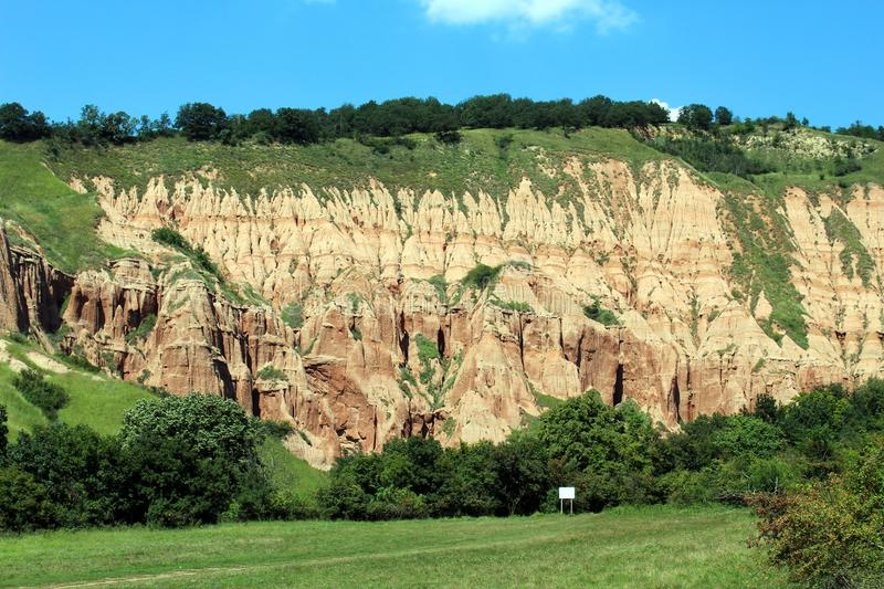 Scenic view with the Red Ravine. A unique natural monument with impressive craggy reddish badlands relief near Sebes city, Alba county, Romania stock image