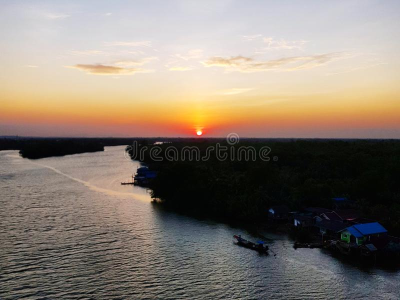 Scenic view of river against sunset sky. Scenic view river against sunset sky sunlight dusk twilight nature dramatic-sky landscape calm idyllic beautiful stock photos