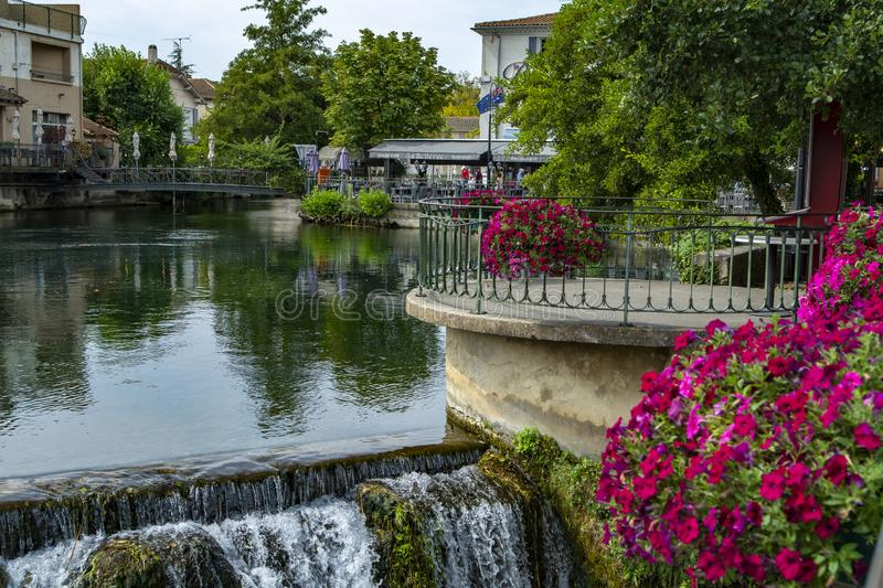 Scenic view on river Sorgue in colorful old town Lisle-sul-la-Sorgue in Provence, France. In summer, tourist destination stock photos