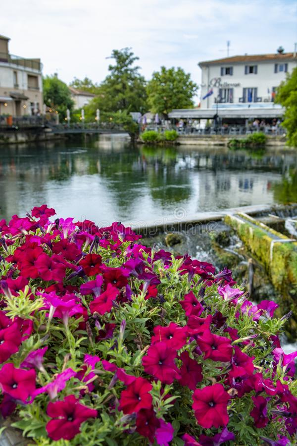 Scenic view on river Sorgue in colorful old town Lisle-sul-la-Sorgue in Provence, France. In summer, tourist destination royalty free stock photo
