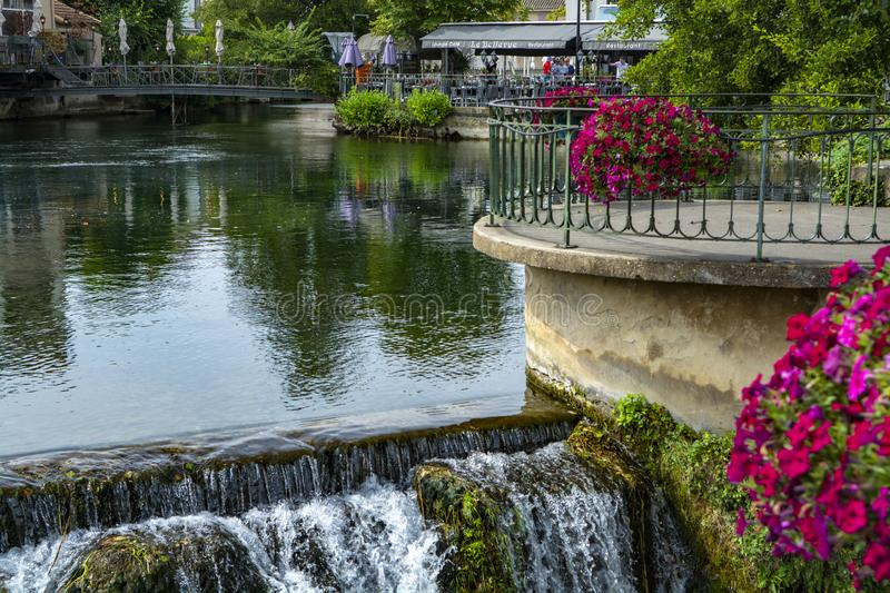 Scenic view on river Sorgue in colorful old town Lisle-sul-la-Sorgue in Provence, France. In summer, tourist destination royalty free stock images