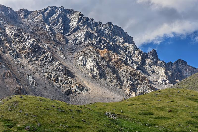 Mountain clouds rock peak slope royalty free stock photography