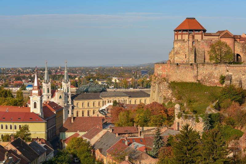 Scenic view of royal castle, roofs and towers in old town of Esztergom, Hungary at sunny autumn day. Scenic view of royal castle, roofs and towers in Watertown stock photo