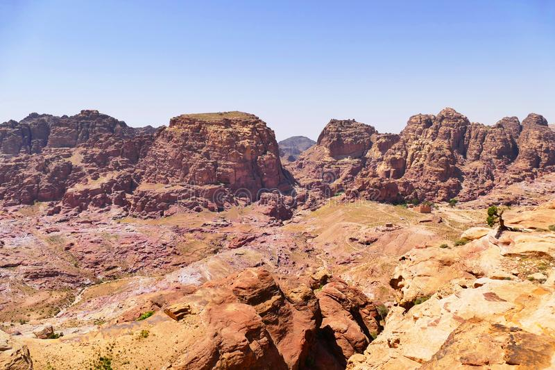The Sacred Valley of The Lost City Of Petra, Jordan. Scenic View The Sacred Valley of The Lost City Of Petra, Jordan from The High Place of Sacrifice Trekking stock images