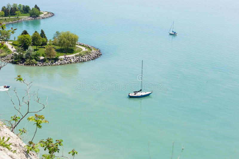 Scenic view of sail boats in a bay at Scarborough Bluffs in Toronto. Top view ofa scence of two sail boats in a bay at Scarborough Bluffs in Toronto royalty free stock image