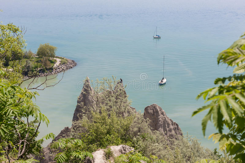 Scenic view of sail boats in a bay at Scarborough Bluffs in Toronto. Top view ofa scence of two sail boats in a bay at Scarborough Bluffs in Toronto royalty free stock photo