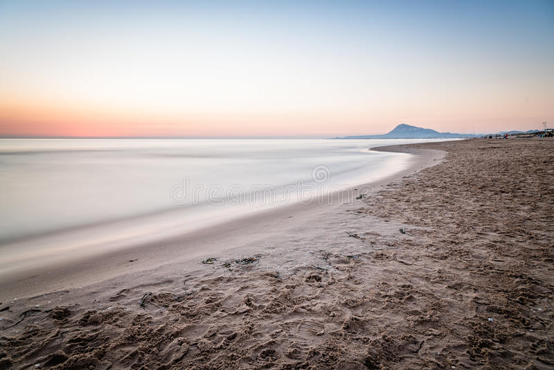 Scenic View Of Sea Against Sky At Morning. In Oliva, Valencia, Spain. Long exposure shot, blurred motion stock images
