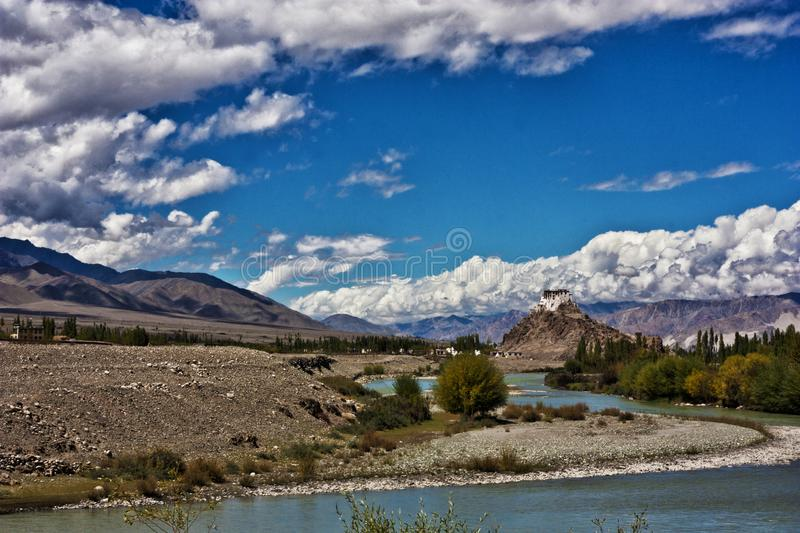 A far flung monastery deep inside the valley of Ladakh, India. A scenic view with skies, clouds, mountain range, valleys with a buddhist monastery in the land of royalty free stock photography
