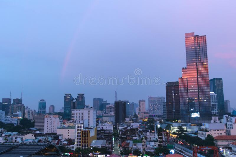 Scenic view of the skyline of Saigon, Vietnam Ho Chi Minh City at dusk. Elevated panoramic shot. Pink clouds can be seen reflected on a tall building royalty free stock photography