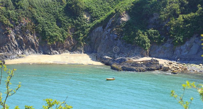 Scenic view small sandy cove Pembrokeshire Wales. Scenic view of a small sandy cove in Dinas Head Pembrokeshire Wales in summer royalty free stock photos