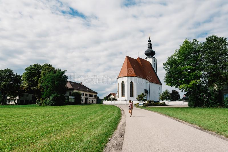 Scenic view of small white church in Austria royalty free stock photography