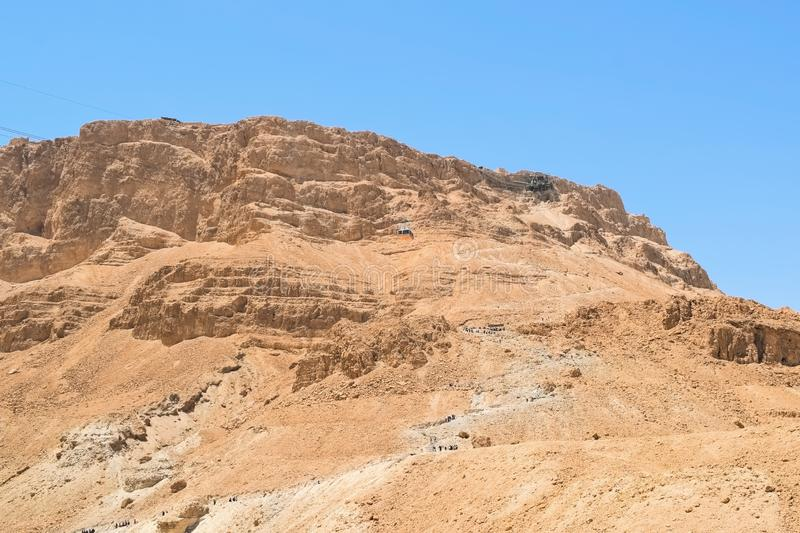 Scenic view of the snake path trail and the cable car to Masada fortress, Masada National Park, Israel royalty free stock photo