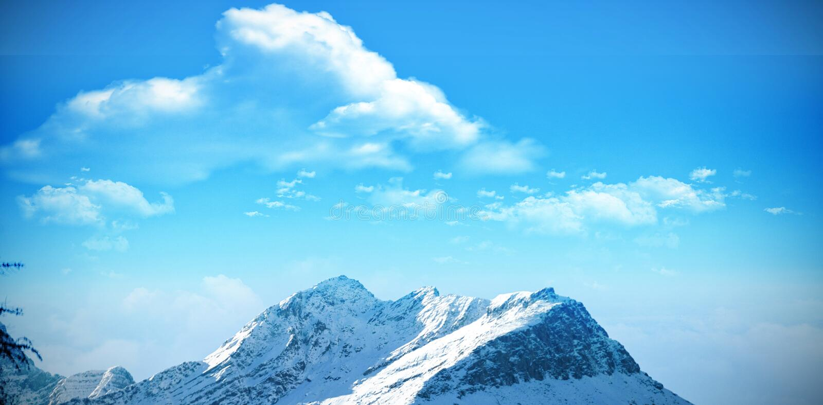 Scenic view of snow covered mountains. Against clear blue sky royalty free stock photos