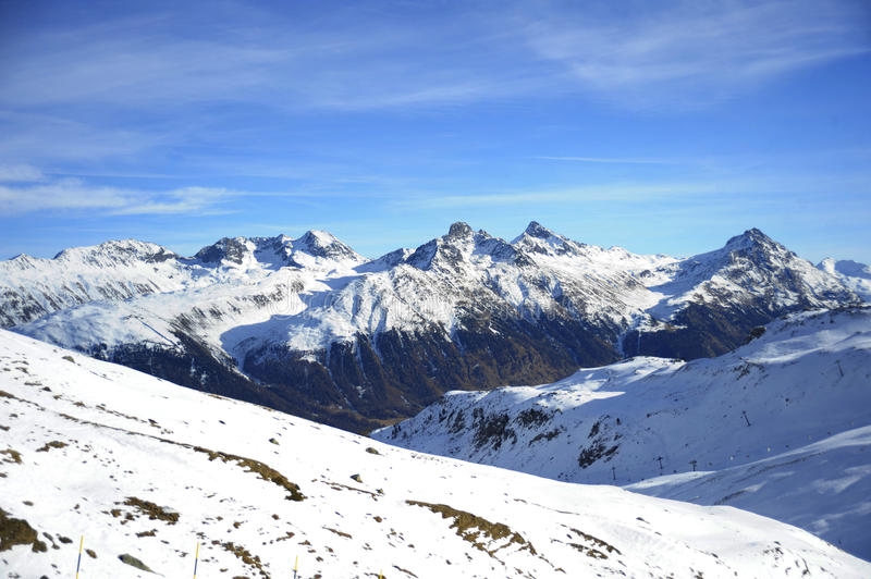 Scenic view of snow mountains and ski resort in Switzerland Europe on a cold sunny day. Amazing scenic view of snow mountains and ski resort in Switzerland stock photos