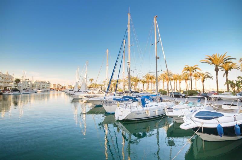 Scenic view of some Yachts in Marina port at dusk, in Benalmadena, Malaga, Spain. stock image
