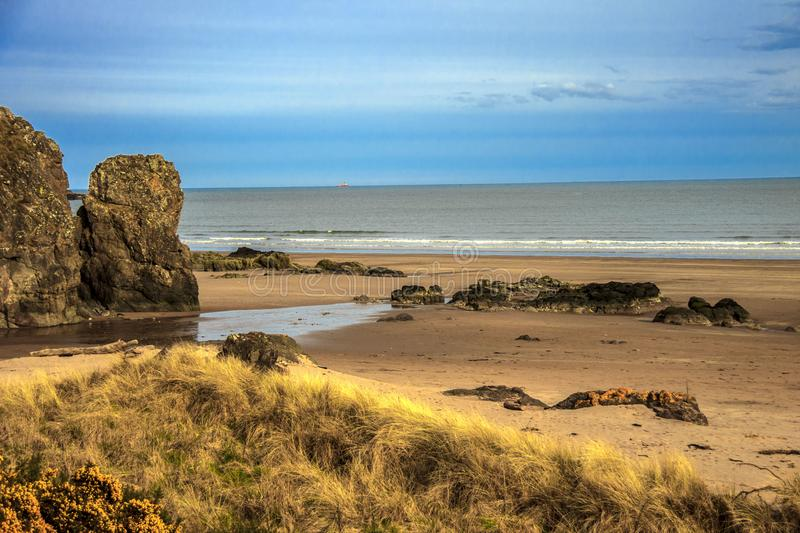 Scottish landscape. St Cyrus Beach, Montrose, Aberdeenshire, Scotland, UK. Scenic view of St Cyrus Beach, Montrose, Aberdeenshire, Scotland, UK. Scotland royalty free stock images