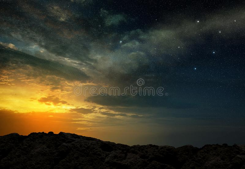 Scenic view of a starry night sky at dawn stock image