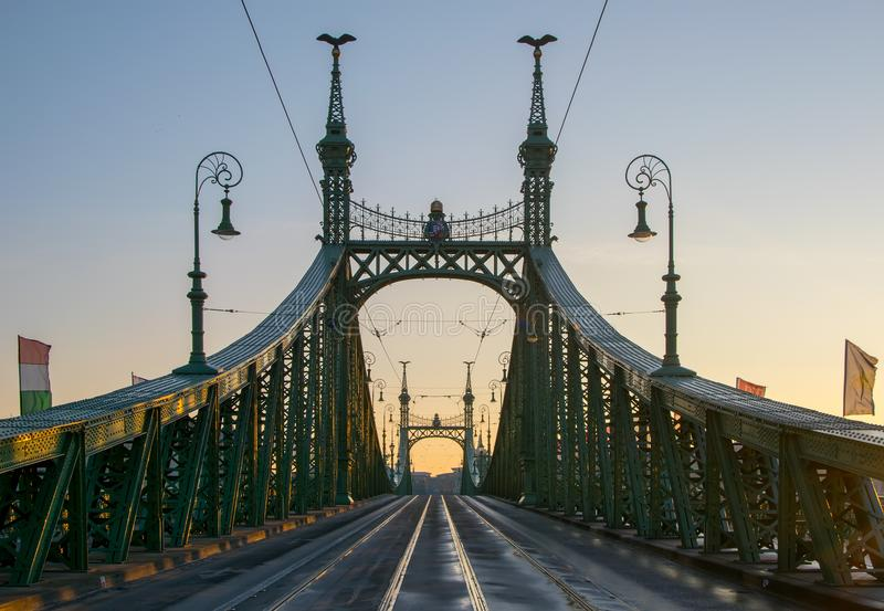 Scenic view of Liberty Bridge at Budapest. Scenic view of Szabadsag hid - Liberty bridge - at Budapest, Hungary at sunrise royalty free stock image