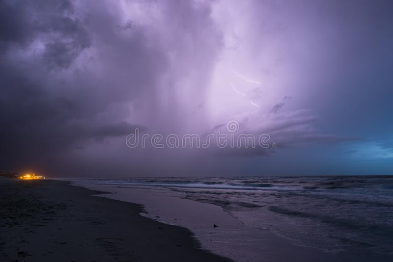 Intracloud lightning in a thunderstorm over the North Sea in the evening stock photo