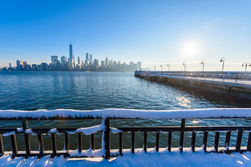 Scenic view to New York, Manhattan over Hudson river from Liberty State Park in wintertime. New Jersey, USA royalty free stock photos