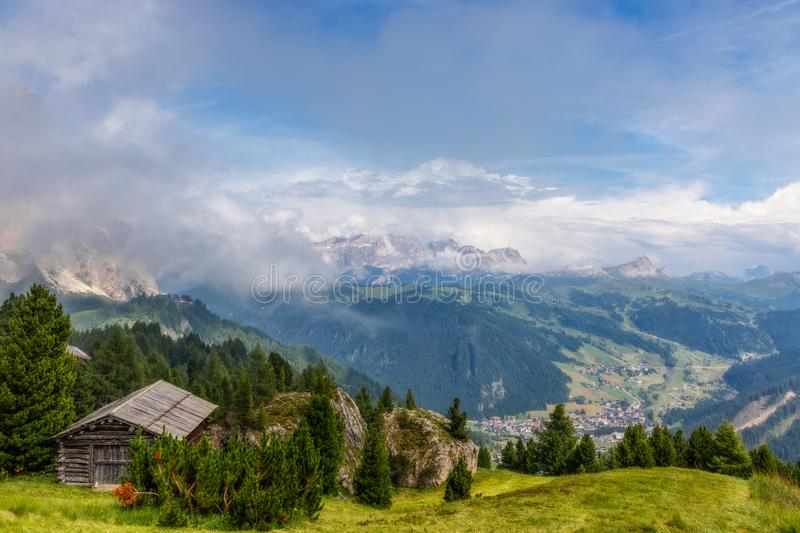 Scenic view from the top of the mountains to the valley covered with fog near the town Colfosco Calfosch stock images