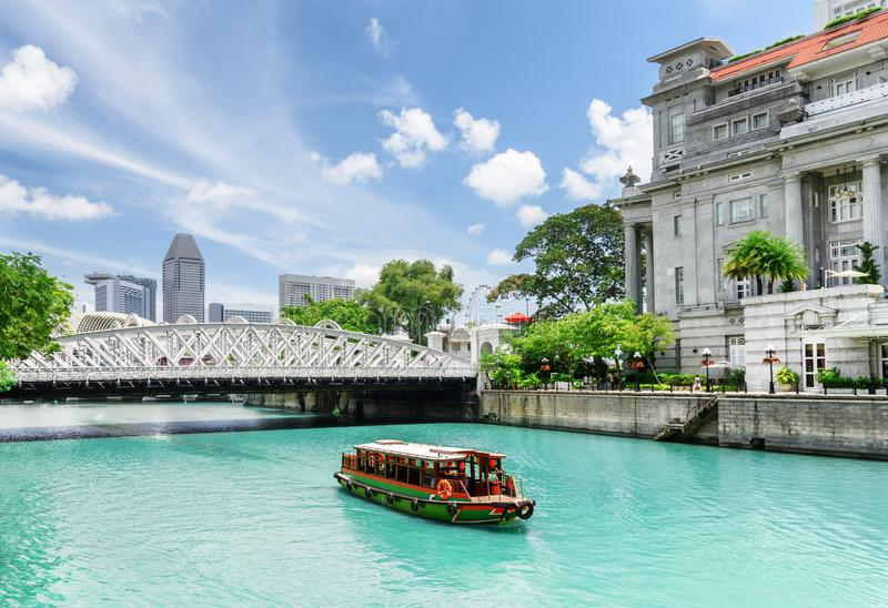 Scenic view of tourist boat sailing along the Singapore River stock photography