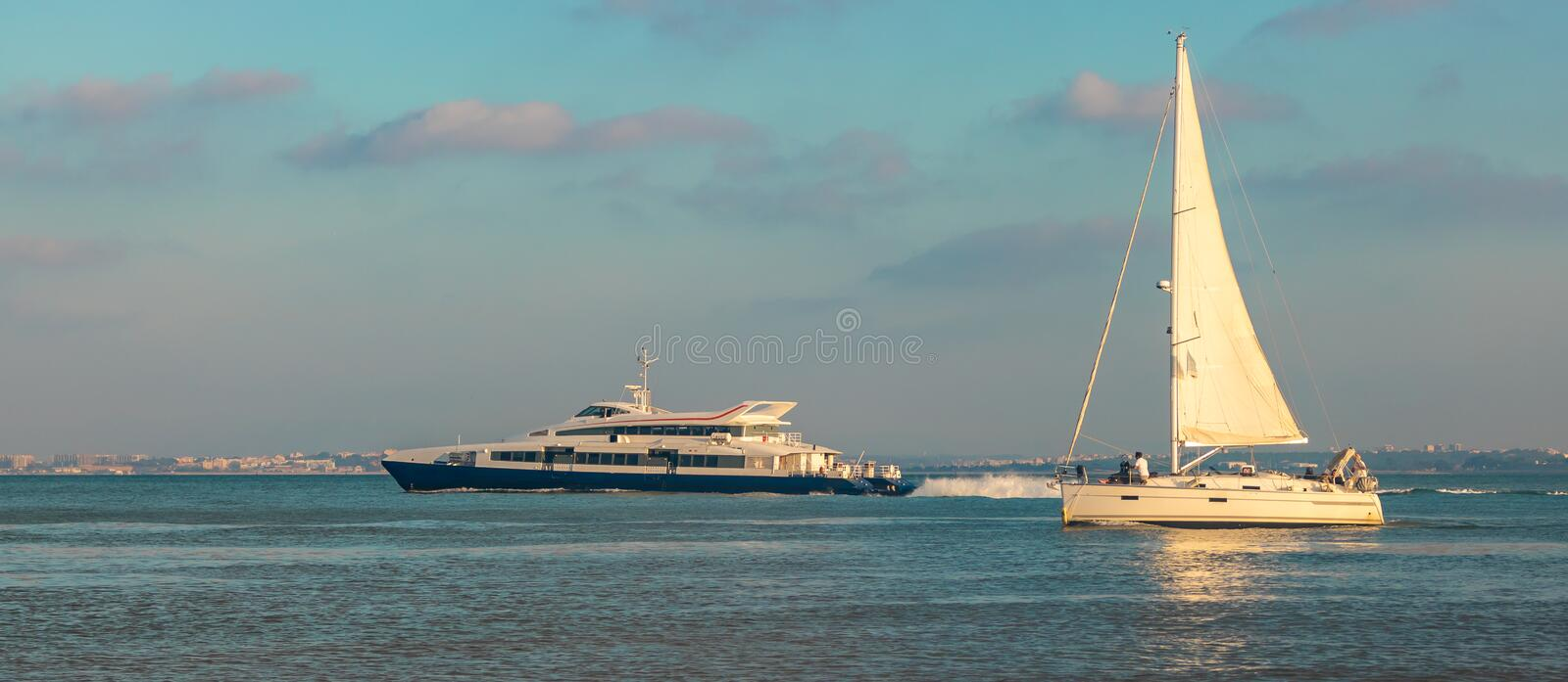 Scenic view of tourists ship and passenger ship in tejo river Lisbon, Portugal in a beautiful sunset. Date 30 July 2019. Attraction, beautiful, boat, building stock photos