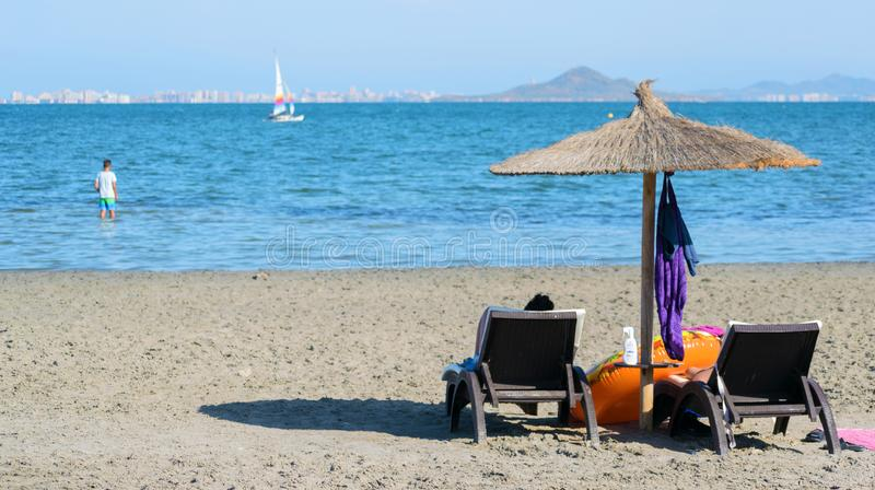 Scenic view of umbrella and chairs at an idyllic beach in the Spanish coast royalty free stock images